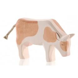 Holztier: Kuh braun fressend
